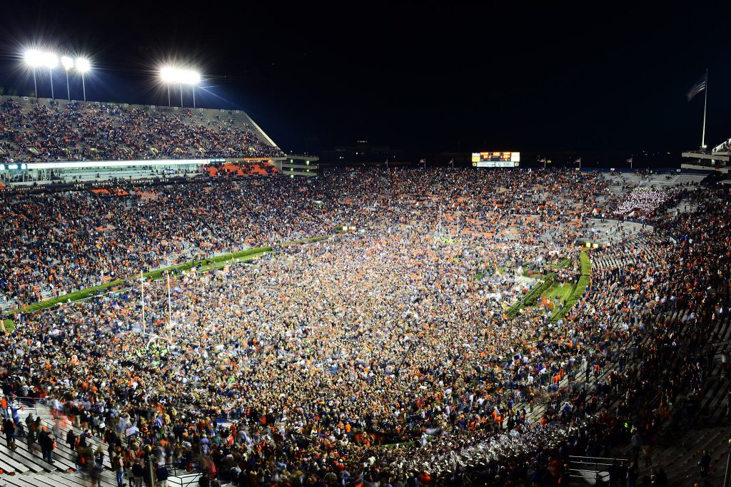 Auburn, AL - November 30, 2013 - Jordan'??Hare Stadium: Fans of the Auburn University Tigers rush the field after winning the Iron Bowl (Photo by Phil Ellsworth / ESPN Images)